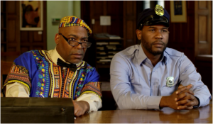 L-R: Jon Cesar as civil rights activist Rev. Charles Maxton, and Che Holloway as Officer Amir Johnson, co-stars of DARK JUSTICE.
