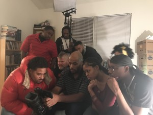BLUE COLLAR HUSTLE director Geoffrey Henderson (at center, holding the camera) surrounded by the series' talented cast.