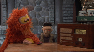 """L-R: Furry Ackermonster (played by Gordon Smuder) and Dwayne Frankenstein (Michael j. Heagle) stand by to hear the results of a radio contest in episode 2 of TVTV, """"Ejaculatron""""."""